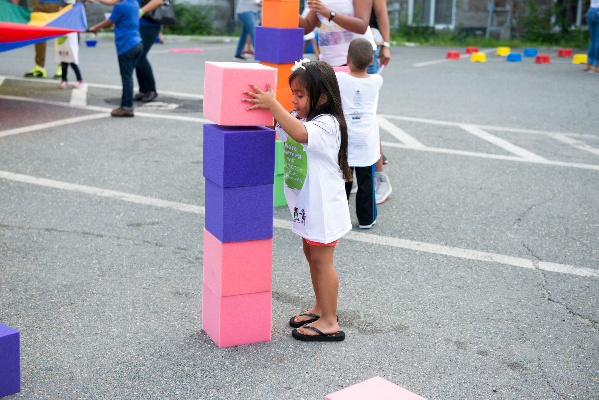 Child stacking big blocks on top of each other